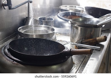Close up of working chef preparing chinese food, Food frying in wok pan. Sale and food concept