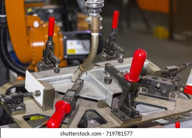 close up workpieces and jig fixture with manual quick clamp for electric mig robot welding process at factory