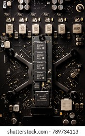 Close up of a workstation black vertical circuit board shows memory module, printed contacts and various capacitors