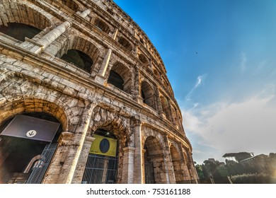 Close up of world famous Coliseum at sunset. Rome, Italy