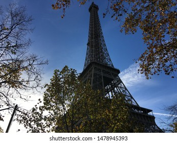 A close up of the world famous Eiffel Tower in the fancy neighborhood within Paris, France.
