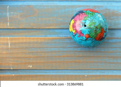 Close up of world globe - showing Asia and America side of world - top view - travel destination and love different cultures concept - place for text