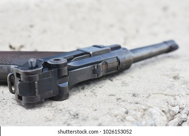 Close up of World War II Pistol on the concrete background