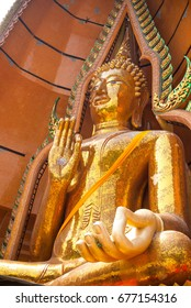 Close up worm eye view of Big Buddha statue at Tiger Cave Temple (Wat Tham Sue) in Kanchanaburi, Thailand