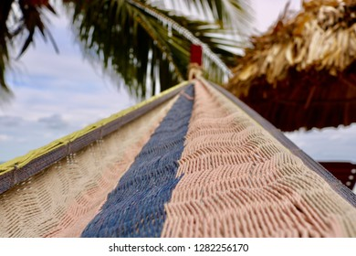 Close up of woven, colorful hammock on a beach in Hopkins, Belize