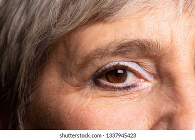 Close up of wrinkled eye of lady with light make up