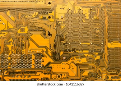 Close up of yellow computer circuit board