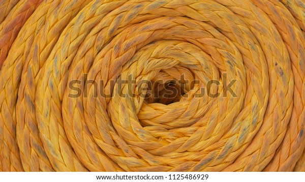 Close up yellow mooring rope.The rope was used.Keep organized.