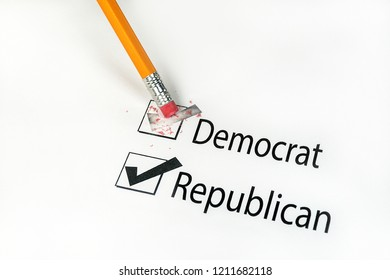 close up of yellow pencil erasing voting choice on election ballot from Democrat to Republican
