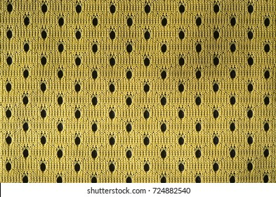 Close up of yellow polyester nylon yellow sportswear shorts to created a textured background