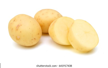 close up of yellow potatoes against white background.