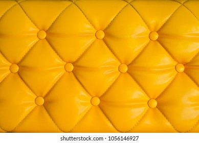 Close up yellow retro chesterfield style, capitone textile background