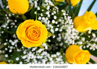 Close up of a yellow rose on a bouquet of flowers