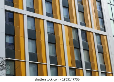 Close up of yellow stripped cladding. Yellow cladding from a student tower block, UK.