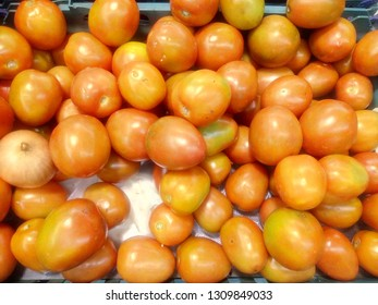 Close up of yellow tomatoes on market