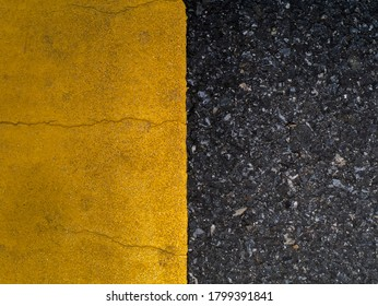 Close up of Yellow traffic lines on the dark asphalt road background