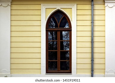 close up yellow wooden building exterior with retro style window in Istanbul, Turkey