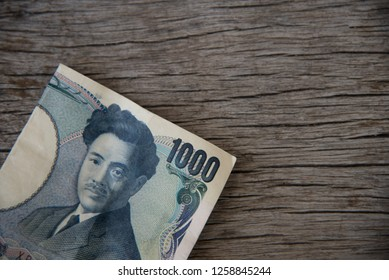 Close up Yen money on wood texture.