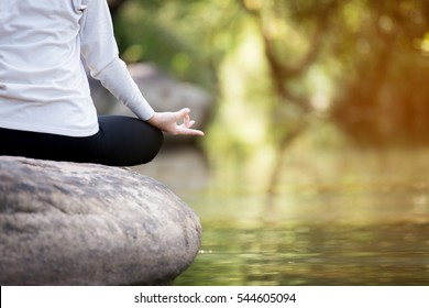 close up of yoga meditating in nature.