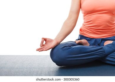 Close up of of yogini woman in yoga asana Padmasana (Lotus pose) cross legged position for meditation with Chin Mudra - psychic gesture of consciousness isolated on white background with copyspace