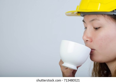 Close up of young architecture women take a break drink coffee.