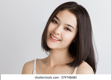 Close up of young Asian beautiful woman with smiley face.