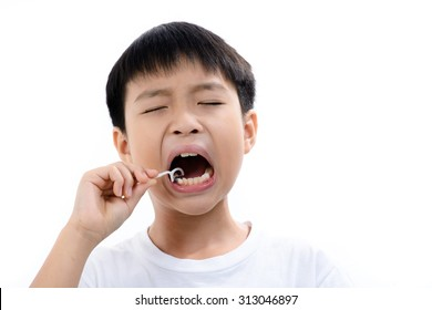 Close up Young asian boy using toothpick to clean his teeth on white background.