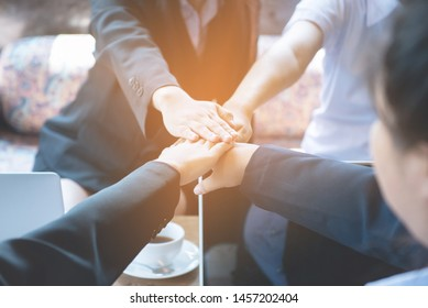 Close up of young asian business woman putting their hands together. Unity and teamwork concept,process in vintage style.