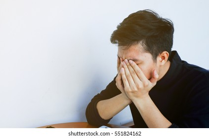 close up young asian employee hand gesture palm up over face head for stress , major of depressive disorder concept