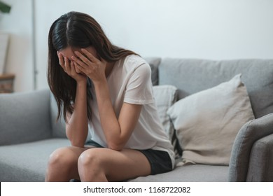 Close up young Asian woman feeling upset, sad, unhappy or disappoint crying lonely in her room.