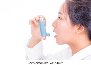 close up young asian woman using inhaler during asthmatic attack