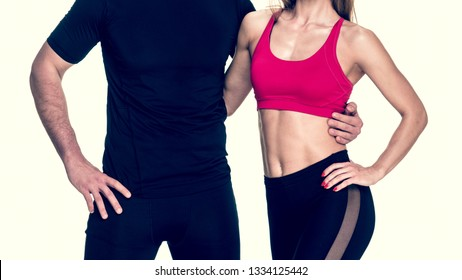 close up of young atrractive fitnes couple smiling and embracing