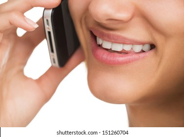 Close up of young attractive woman talking on the smart phone