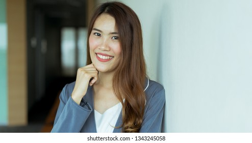 close up young beautiful asian businesswoman secretary smiling at office , working concept