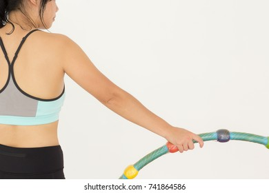 Close Up of Young Beautiful Asian Fleshy Woman in Sportswear with Hula Hoop on White Isolated. Idea Concept for Exercise to Lose Weight. Copy Space for Text.