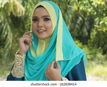 Close up of young beautiful Asian muslim woman wearing hijab.