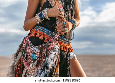 close up of young boho style woman on the beach at sunset