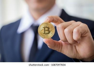 Close up young business man holding bitcion.