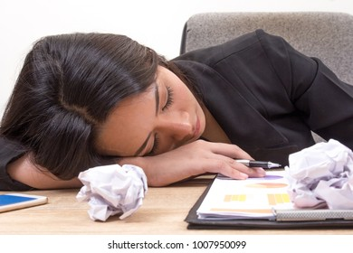 Close up young business woman Sleep on table. Overworking girl in office, stressed from work overload on desk, tired and sleepy lady. Busy schedule hard work concept.