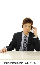 Close up young businessman with headset in office