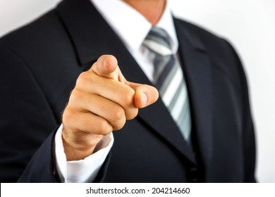 Close up of a young businessman, pointing with his finger.