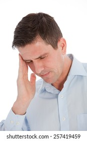Close up Young Businessman Touching his Head with CLosed Eyes While Suffering From Headache. Isolated on White Background.