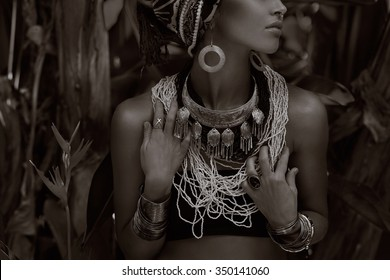 close up of young caucasian woman with silver jewelry. Black and white portrait
