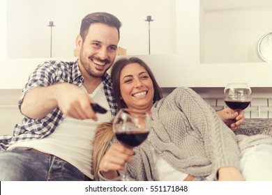 Close up of a young couple enjoying wine at home