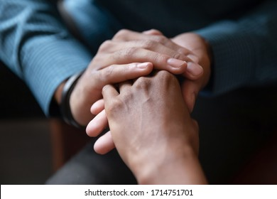 Close up of young  couple hold hands talking sharing secrets showing love and care,  husband and wife have tender close moment together, demonstrate support and understanding