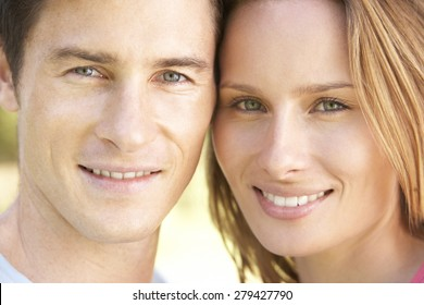 Close Up Of Young Couple's Faces