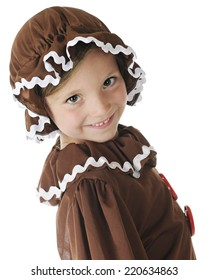 "Close up of a young elementary ""gingerbread girl"" smiling at the viewer.  On a white background."