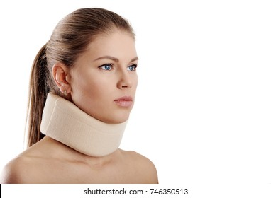 Close up of young female wearing neck collar on white background. Concept of osteoporosis or neck injury.