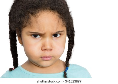 Close up Young Girl Staring at You with Angry Facial Expression Against White Background.