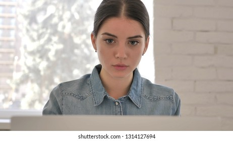 Close Up of Young Girl Working On Laptop
